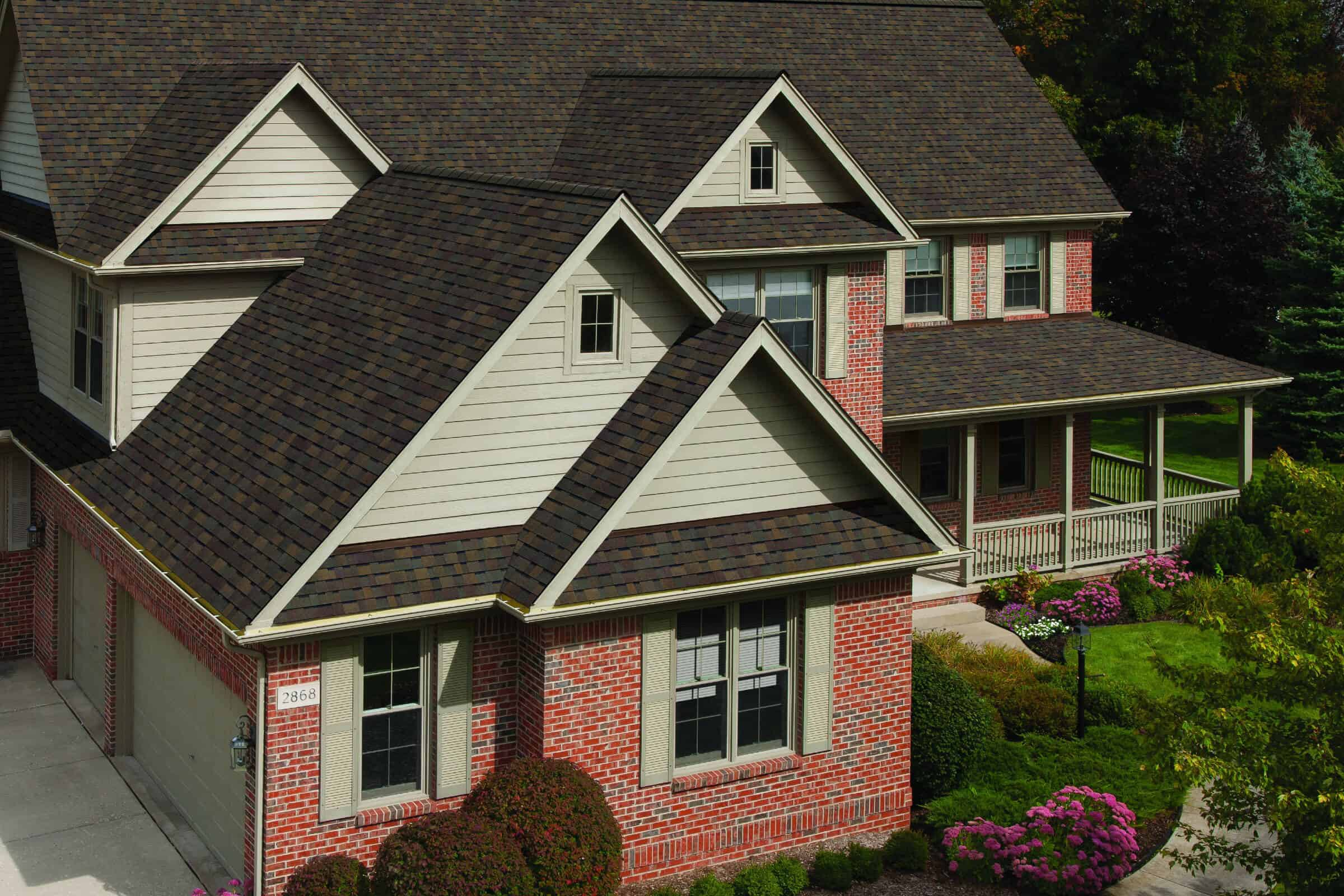 Red brick home with asphalt roofing